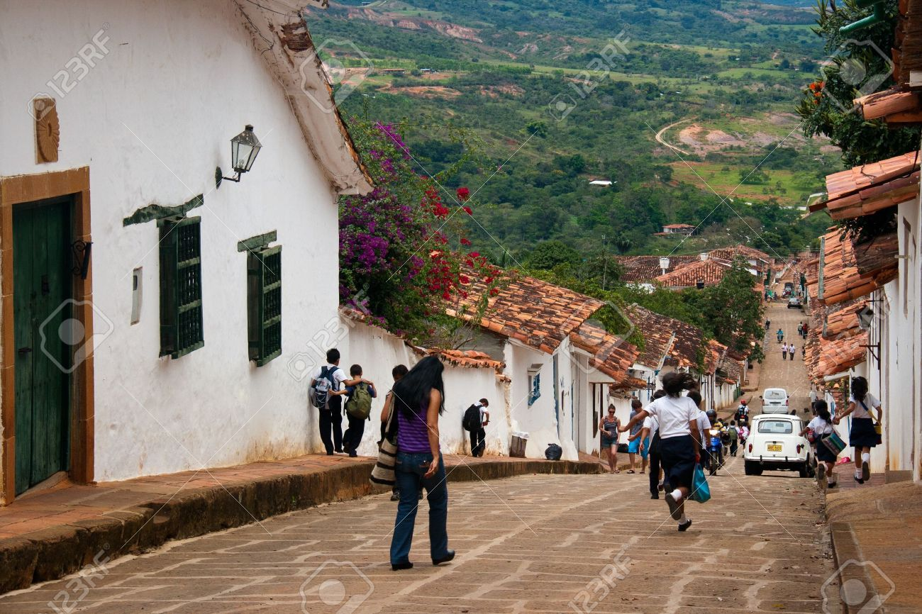 School children running the streets of the colonial village of Barichara, Santander, Colombia Stock Photo - 15438071
