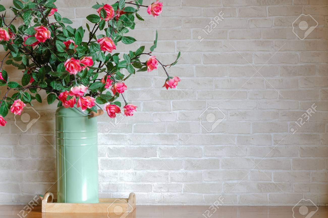 A Bunch Of Artificial Cherry Red Roses In A Tall Tin Green Vase Stock Photo Picture And Royalty Free Image Image 100683036