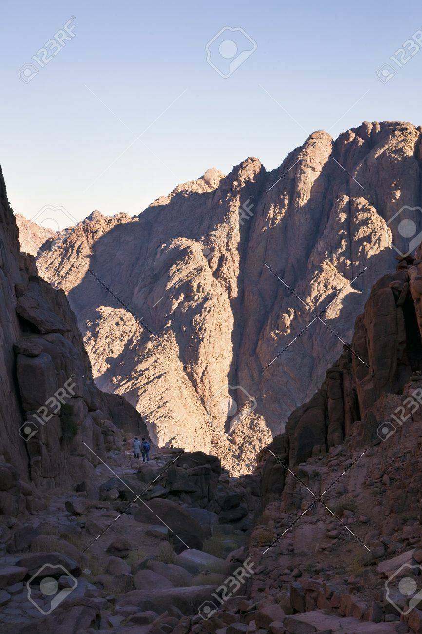 Tourists or light and dark side of Sinai Mountains Stock Photo - 12323811