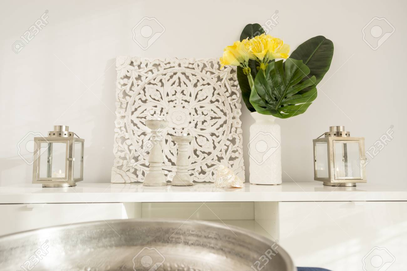 Yellow Flowers In Ceramic Vase With Wooden Candlesticks And Lantern Stock Photo Picture And Royalty Free Image Image 99776565