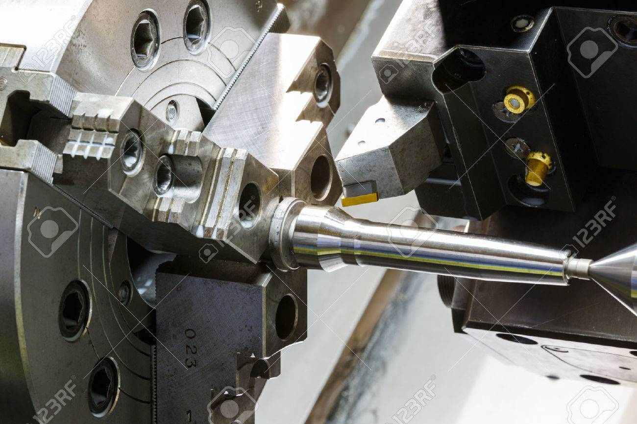 industrial metal work machining process by cutting tool on CNC lathe - 32141778
