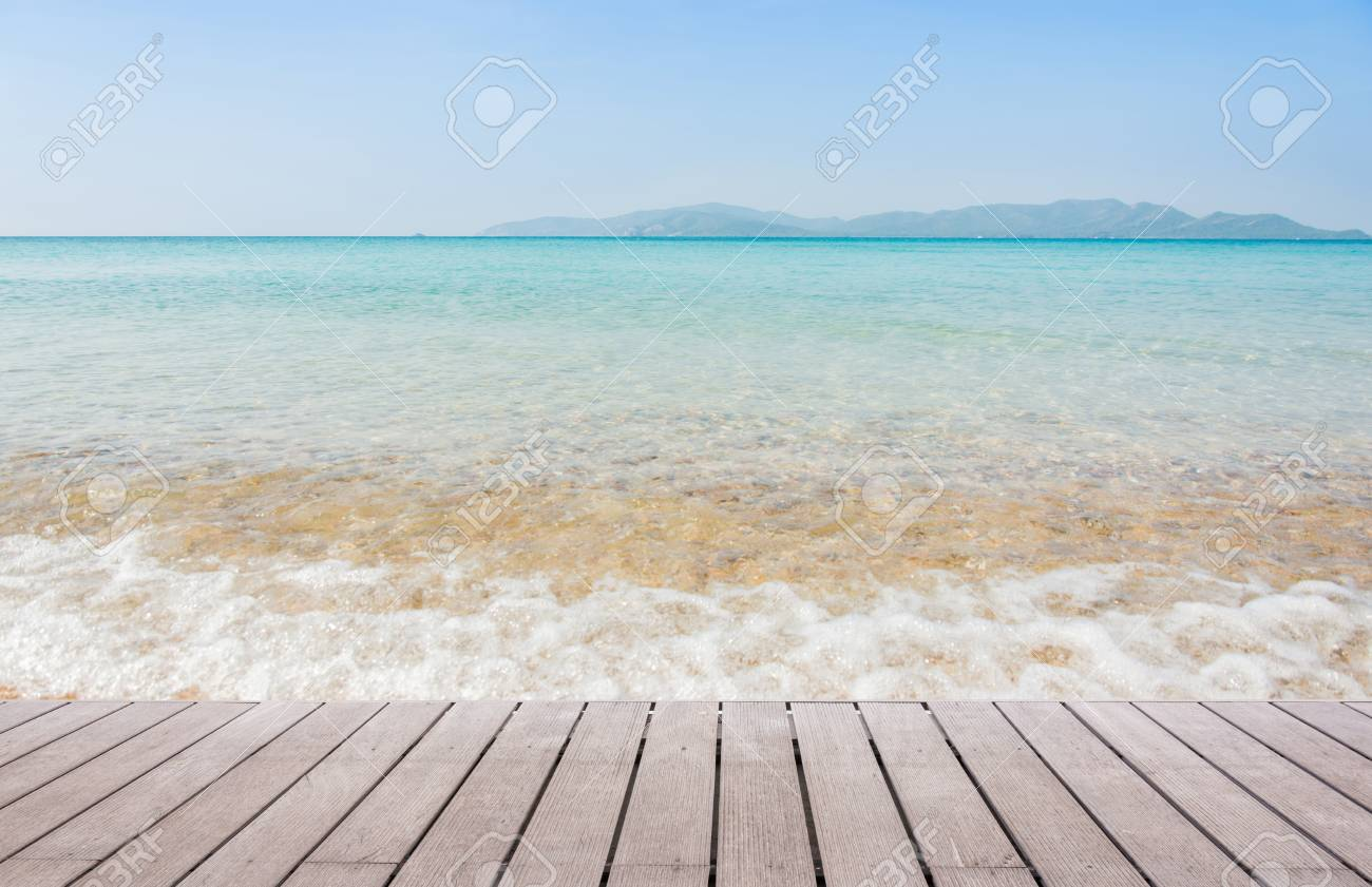 beach scene with wooden floor background can put or montage your