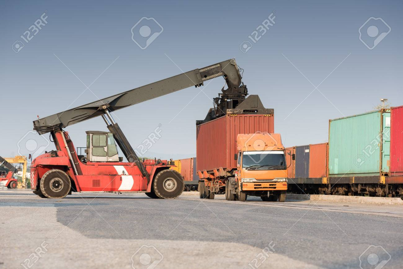 forklift handling container loading box from freight train to