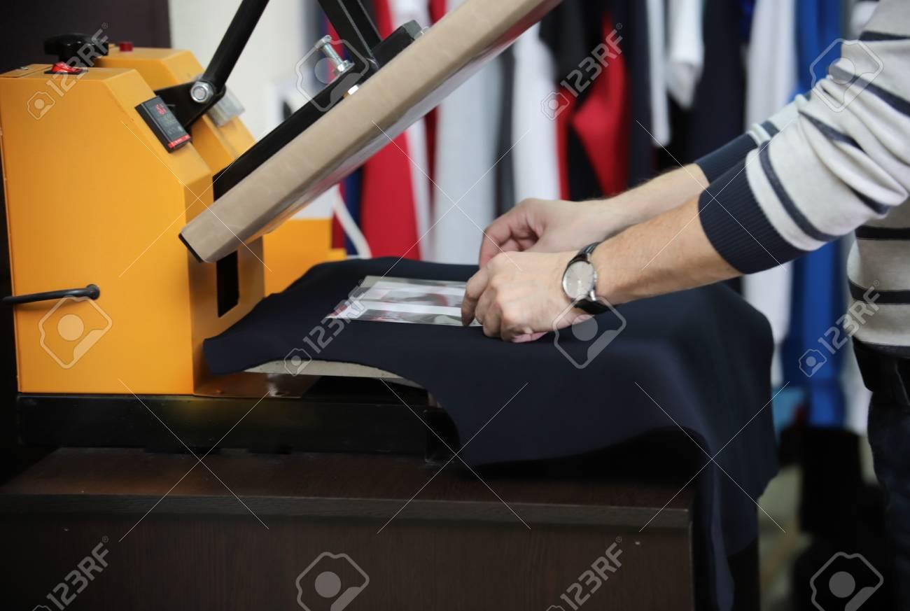 Man Preparing T Shirt For Printing In The Silk Screen Printing