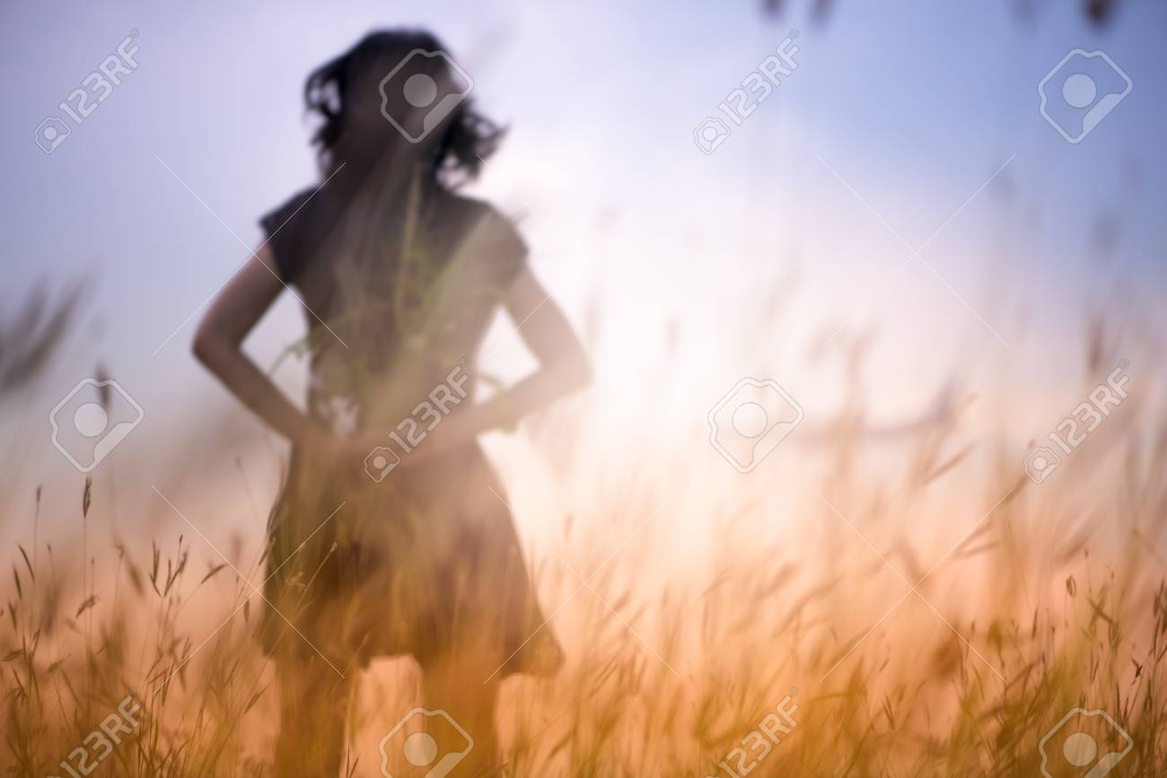 Blur photo of emotions moment of girl with flowers waiting for first summer. - 85234213