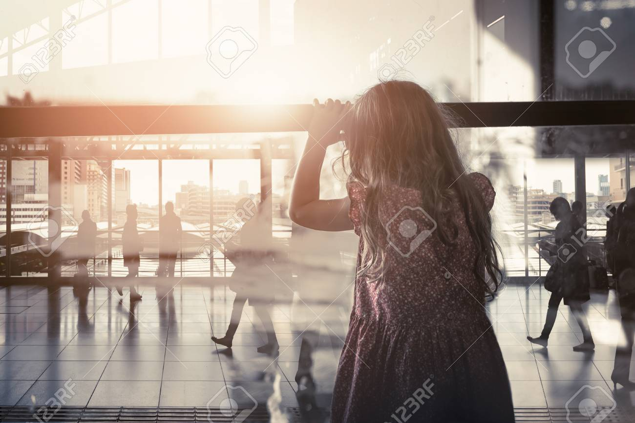 The little girl looking through the window farewell feelings alone. Dark tone color sadness emotions concept. - 85100529