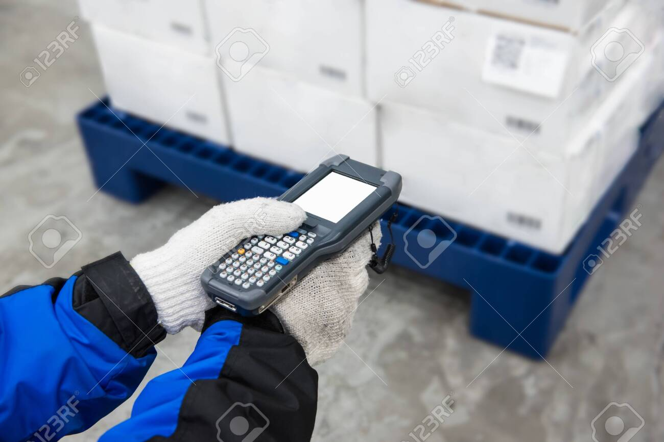 Bluetooth barcode scanner checking goods in the cold room or