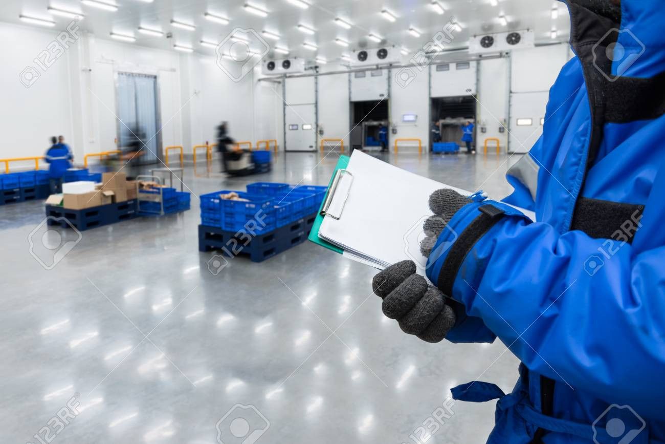 Hand of worker with clipboard checking ready meals goods in the warehouse., Import and export management system for customer service concept. - 123068009