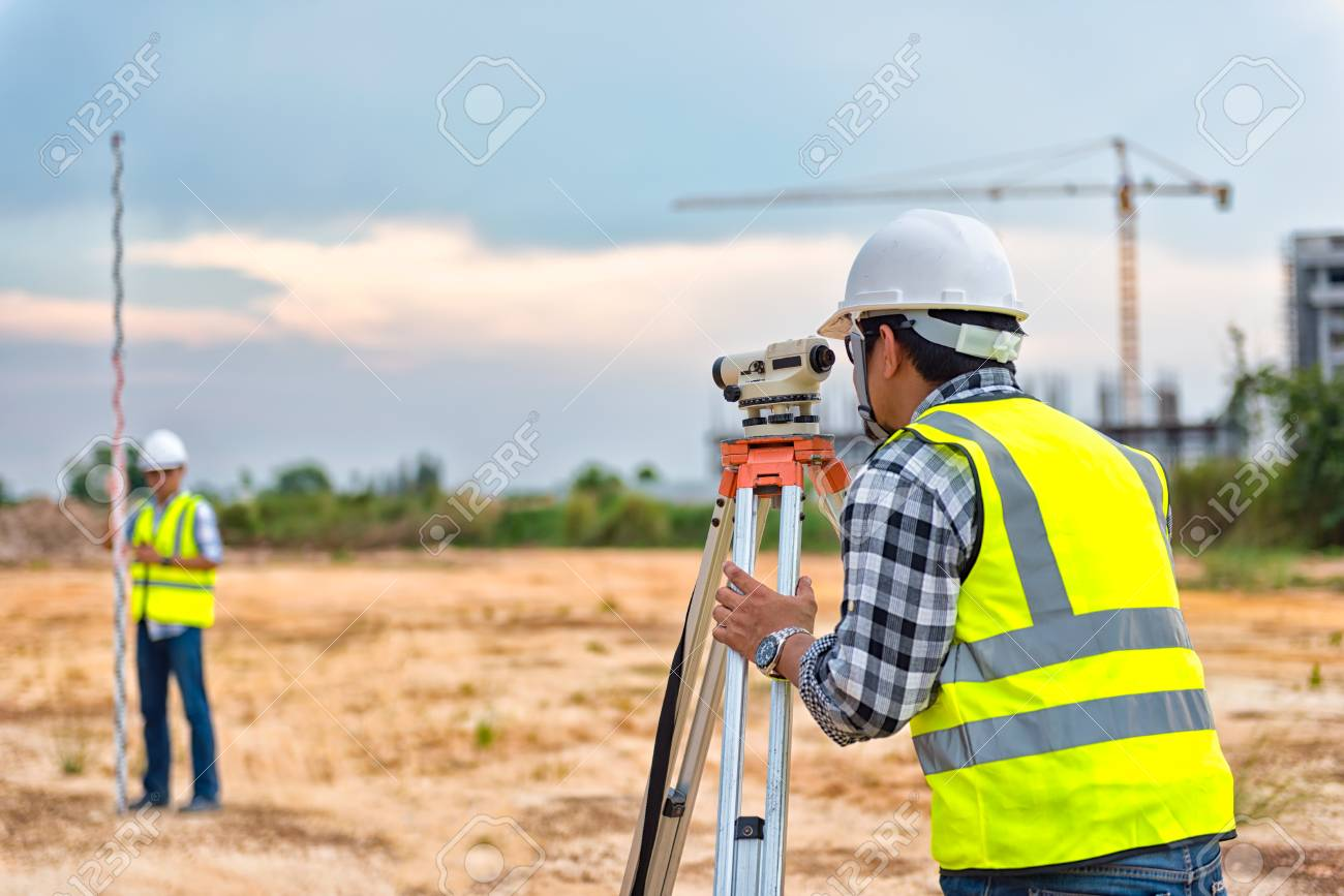 Surveyor equipment. Surveyor's telescope at construction site or Surveying for making contour plans are a graphical representation of the lay of the land before startup construction work - 123217142
