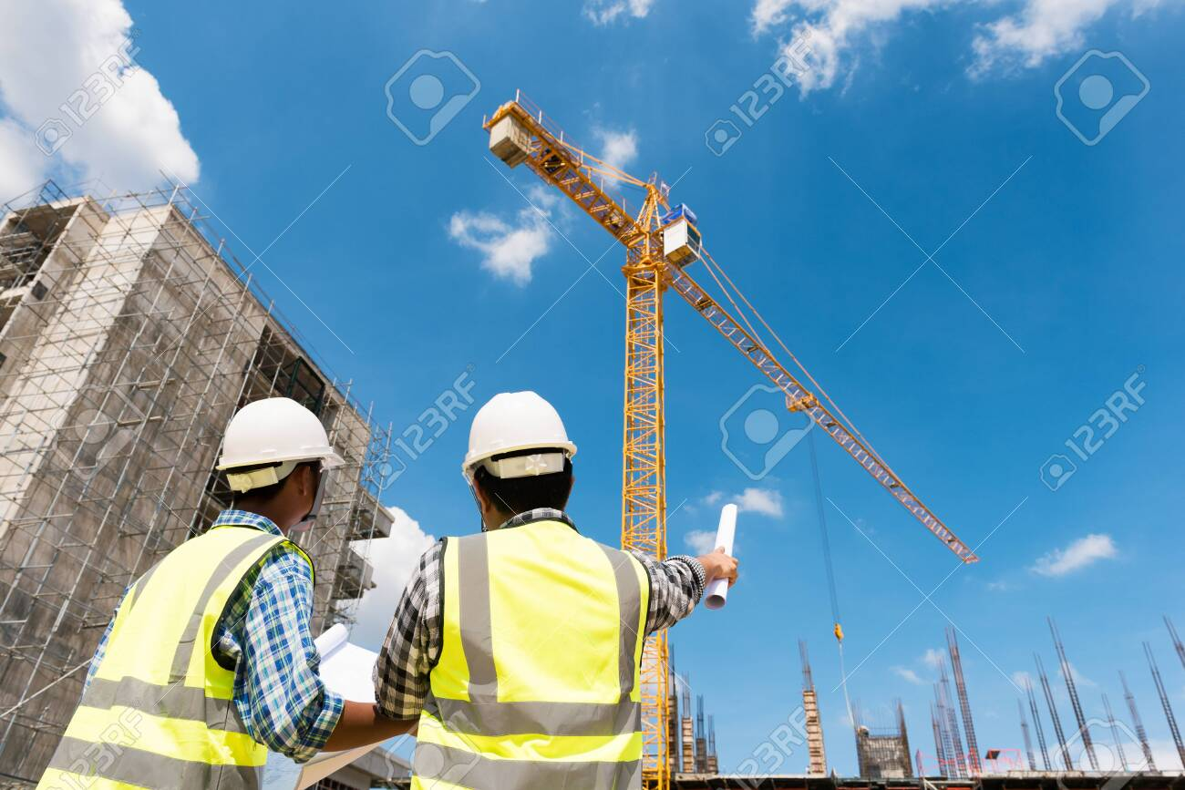 Construction engineers discussion with architects at construction site or building site of highrise building - 123216854