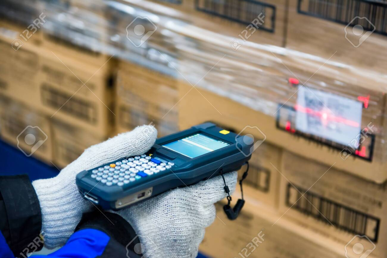 barcode scanner checking goods in the cold room or warehouse - 123499119