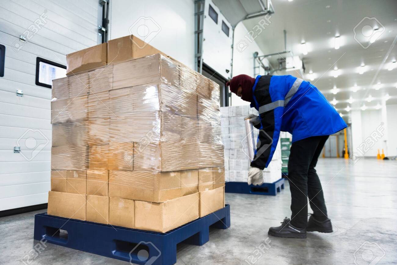 Plastic wrapper roll to packaging in loading goods of the freezing warehouse. Storage for Ready-made foods or Ready-to-Eat Foods. Export-Import Logistics system concept. - 123499489