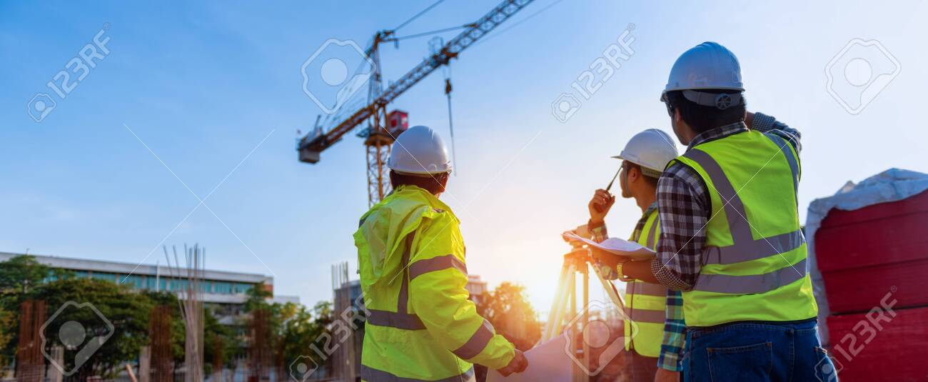 Construction engineers discussion with architects at construction site or building site of highrise building with Surveying for making contour plans is a graphical representation of the lay in land. - 123730915
