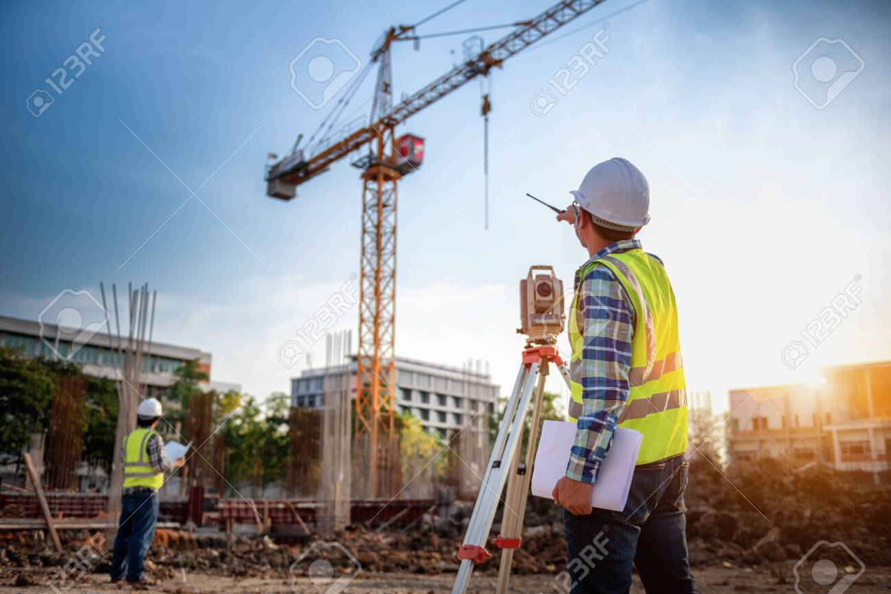 Surveyor equipment. Surveyor's telescope at construction site or Surveying for making contour plans is a graphical representation of the lay of the land startup construction work. - 123730928
