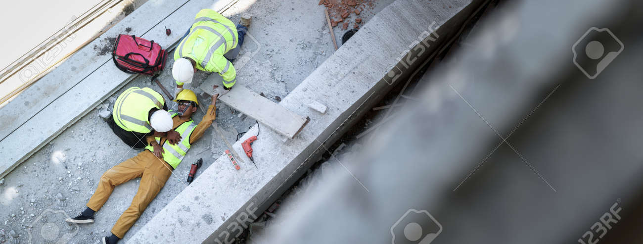 First aid, Start Compressions using both hands, Life-saving and rescue methods after unconscious. Accident at work in construction job of worker near construct building. Banner with copy space - 171975363