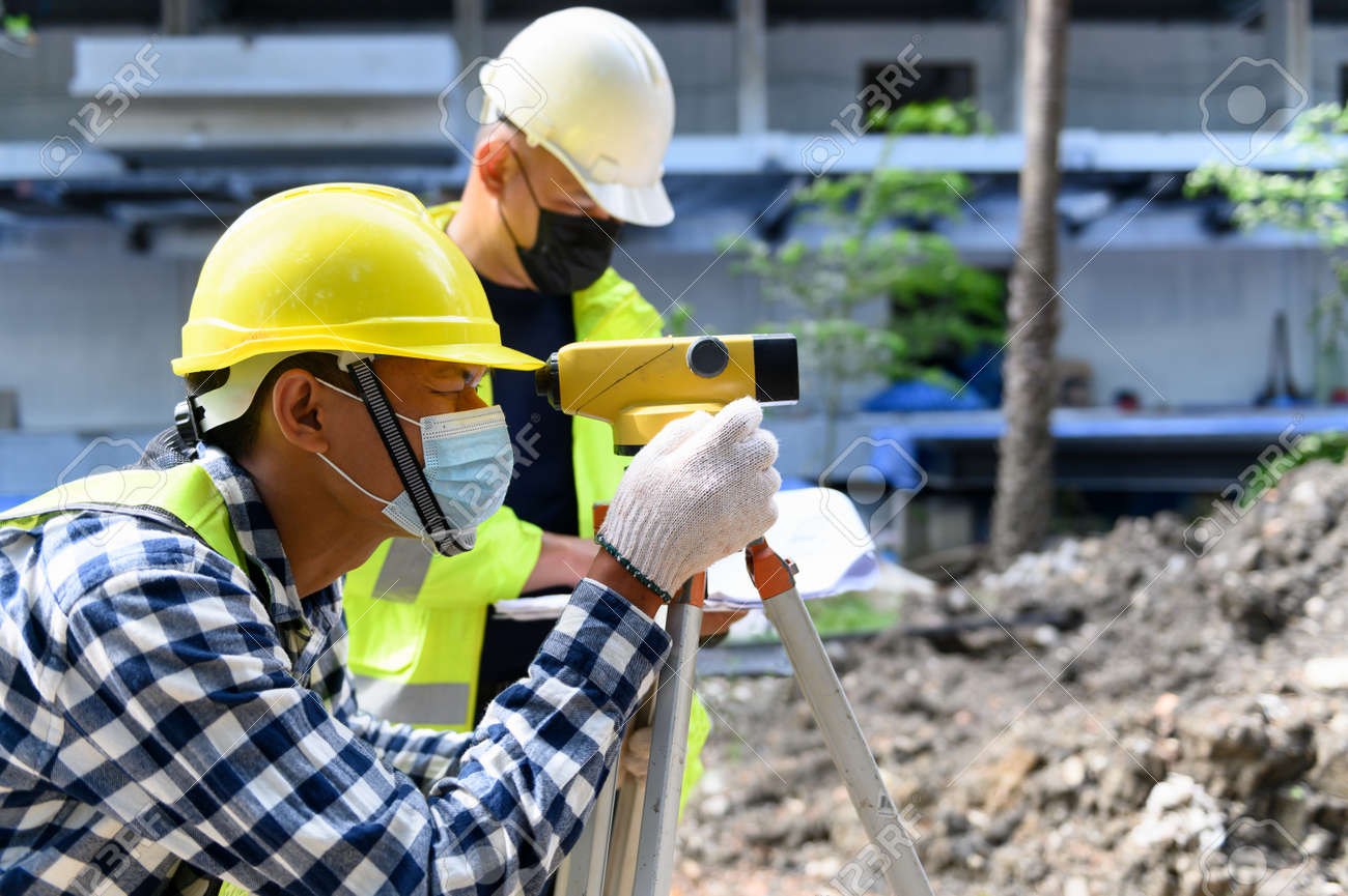 Surveyor equipment. Surveyor's telescope at construction site or Surveying for making contour plans is a graphical representation of the lay of the land startup construction work. - 171974386