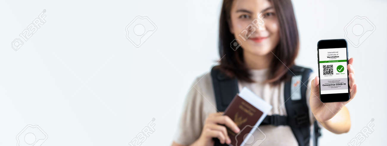 Tourist uses of application on smartphone to show an international certification of vaccination at airport with Immunity passport and vaccination record card , Disease immunity passport. - 171974317