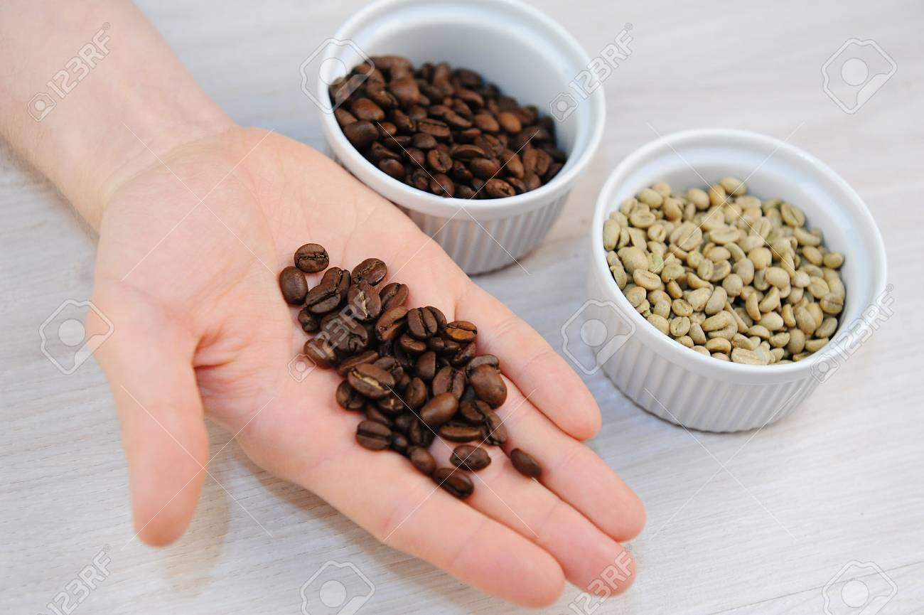 Unroasted Coffee Beans >> Roasted And Green Unroasted Coffee In Bowls Freshly Roasted