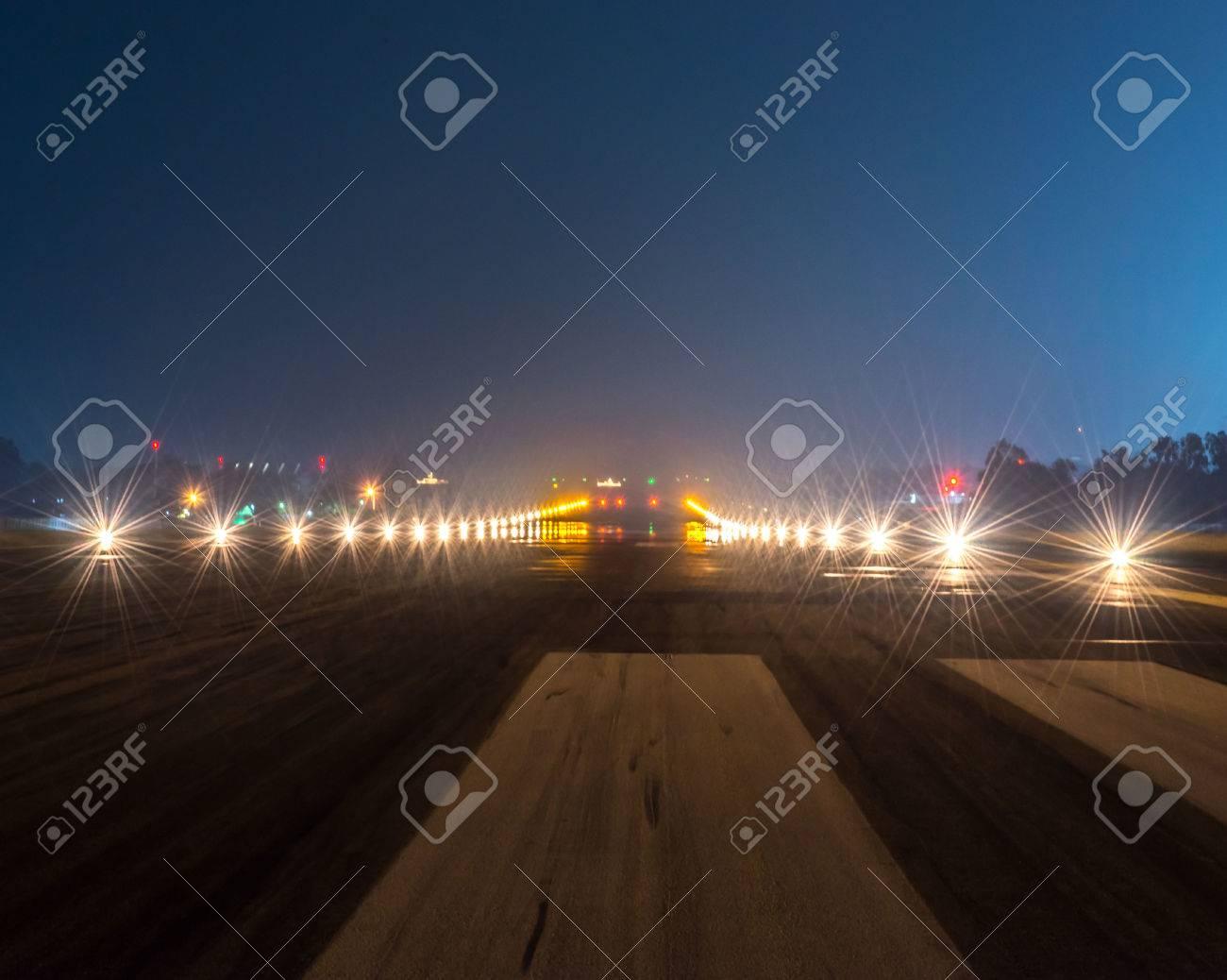 Landing lights at night closeup. - 48539421