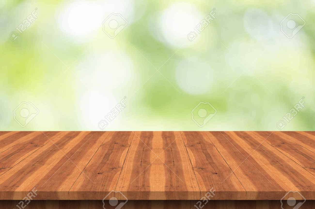 Empty Teak Wood Table Top On Nature Green Blurred Background Space
