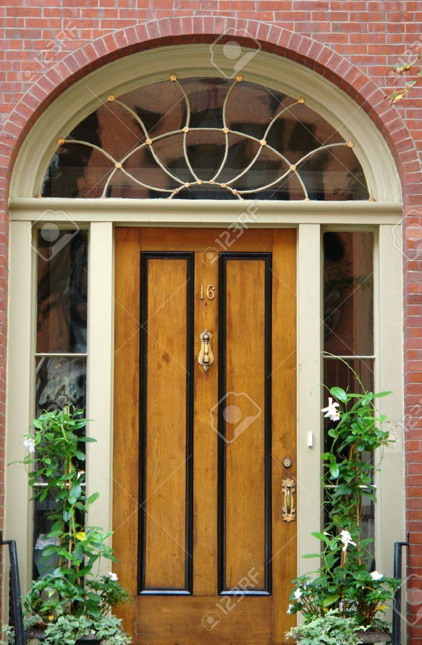 Natural woodgrain door with black trim brass number and door knocker and handle arched & Natural Woodgrain Door With Black Trim Brass Number And Door ... Pezcame.Com