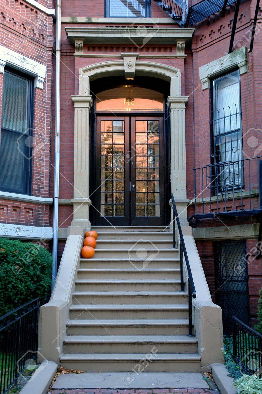 Brown French Double Doors Sitting Stately Atop Of Cement Stairs ...