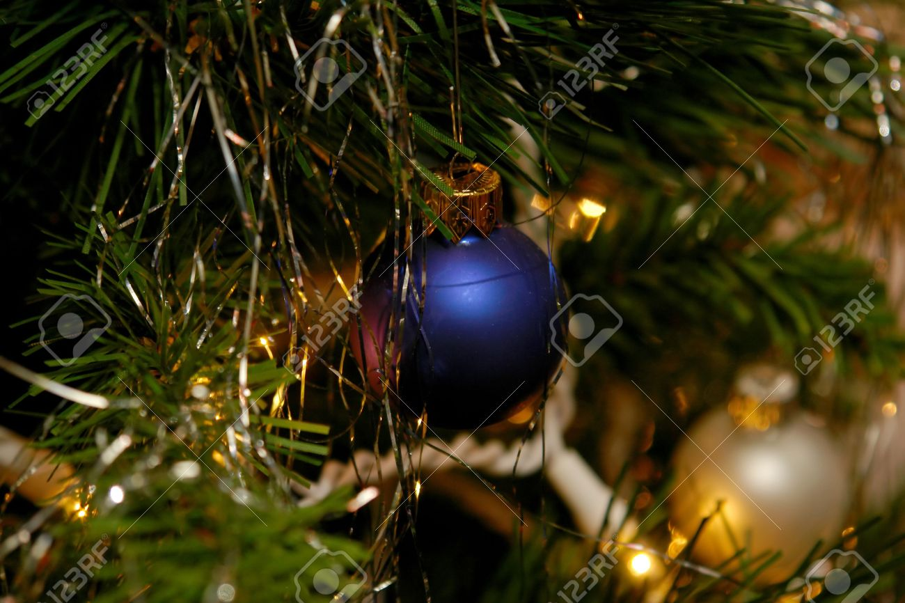 Close Up Of The Ornaments On An Indoor Christmas Tree With White Light Bulbs Stock Photo