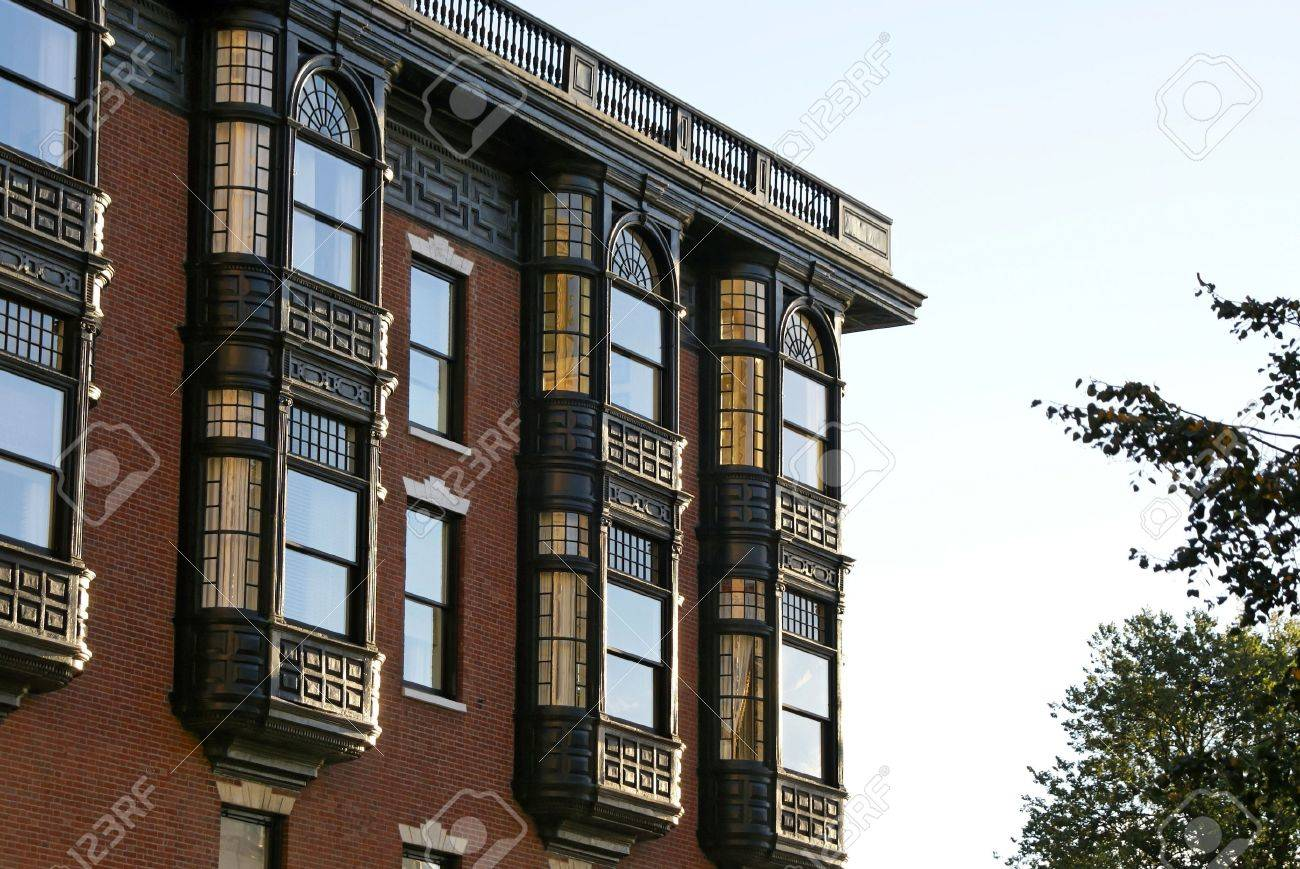 Upper Floors Of Old Brownstone Apartment Building In Boston Massachusetts On A Fall Afternoon