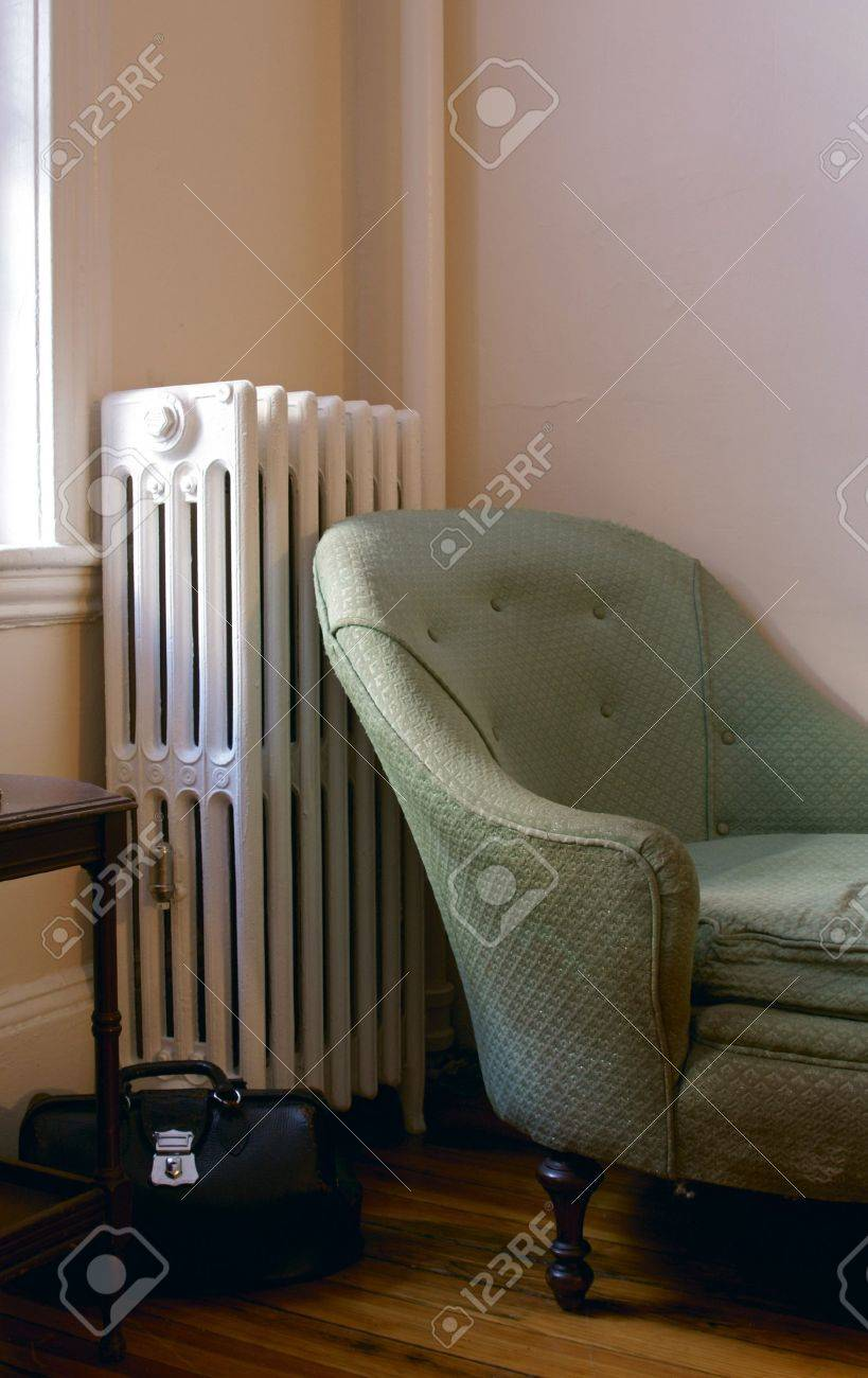 old living room showing steam radiator, chaise lounge sofa, end..
