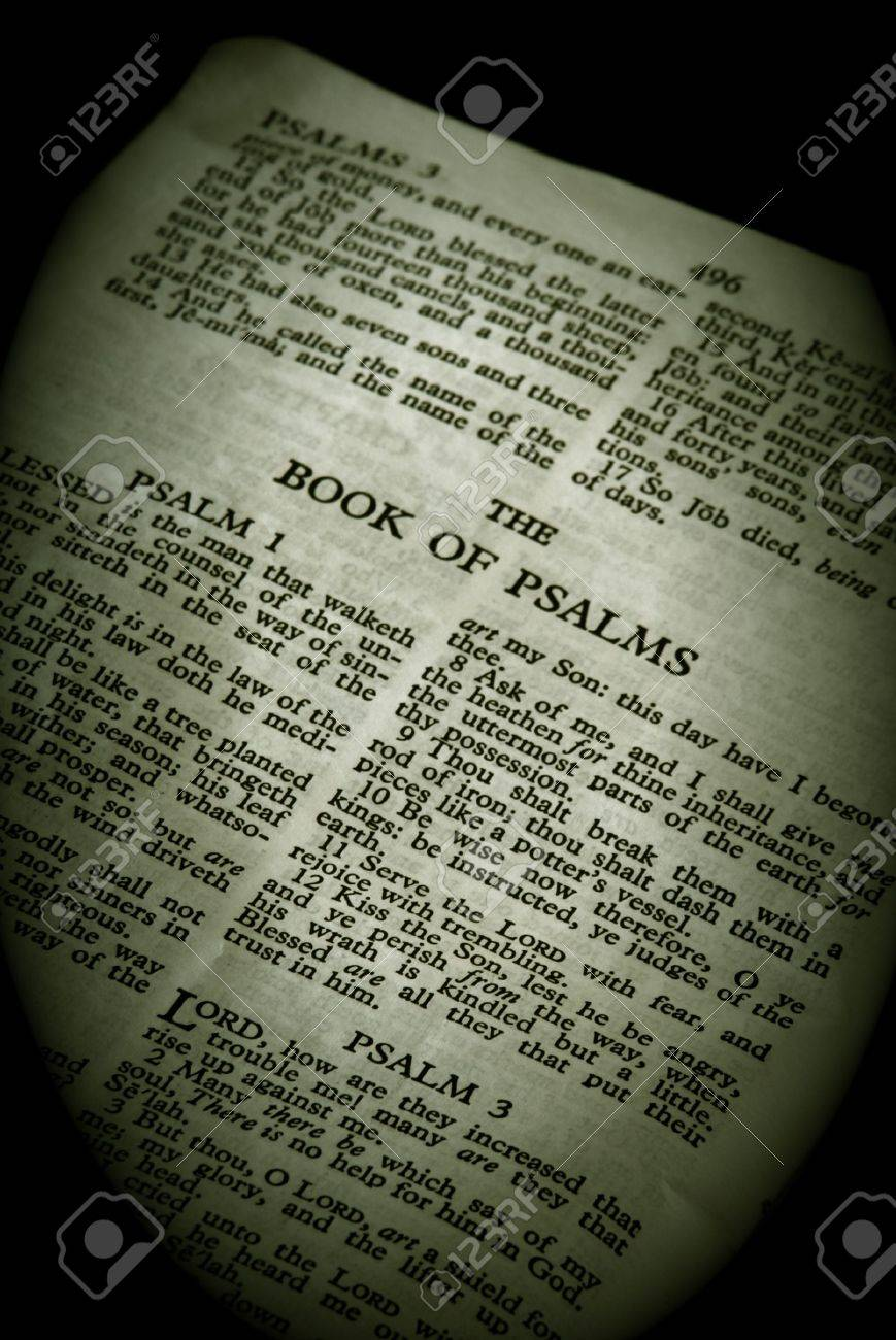 bible series, detail of an old antique holy bible against a black background open to the book of psalms old testament finished in sepia Stock Photo - 2416339