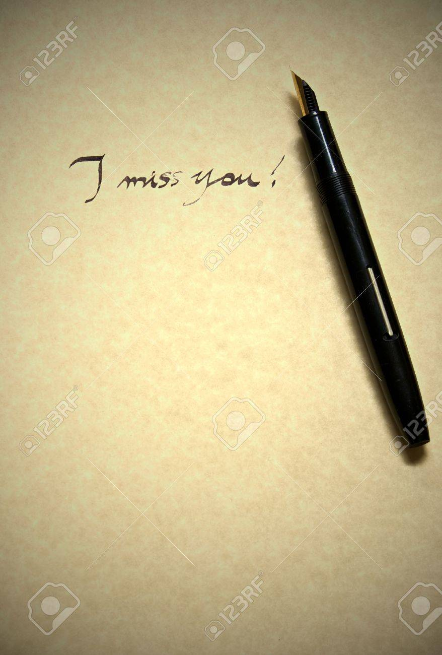 i miss you leter being written in calligraphy on parchment paper stock photo i miss you leter being written in calligraphy on parchment paper pen