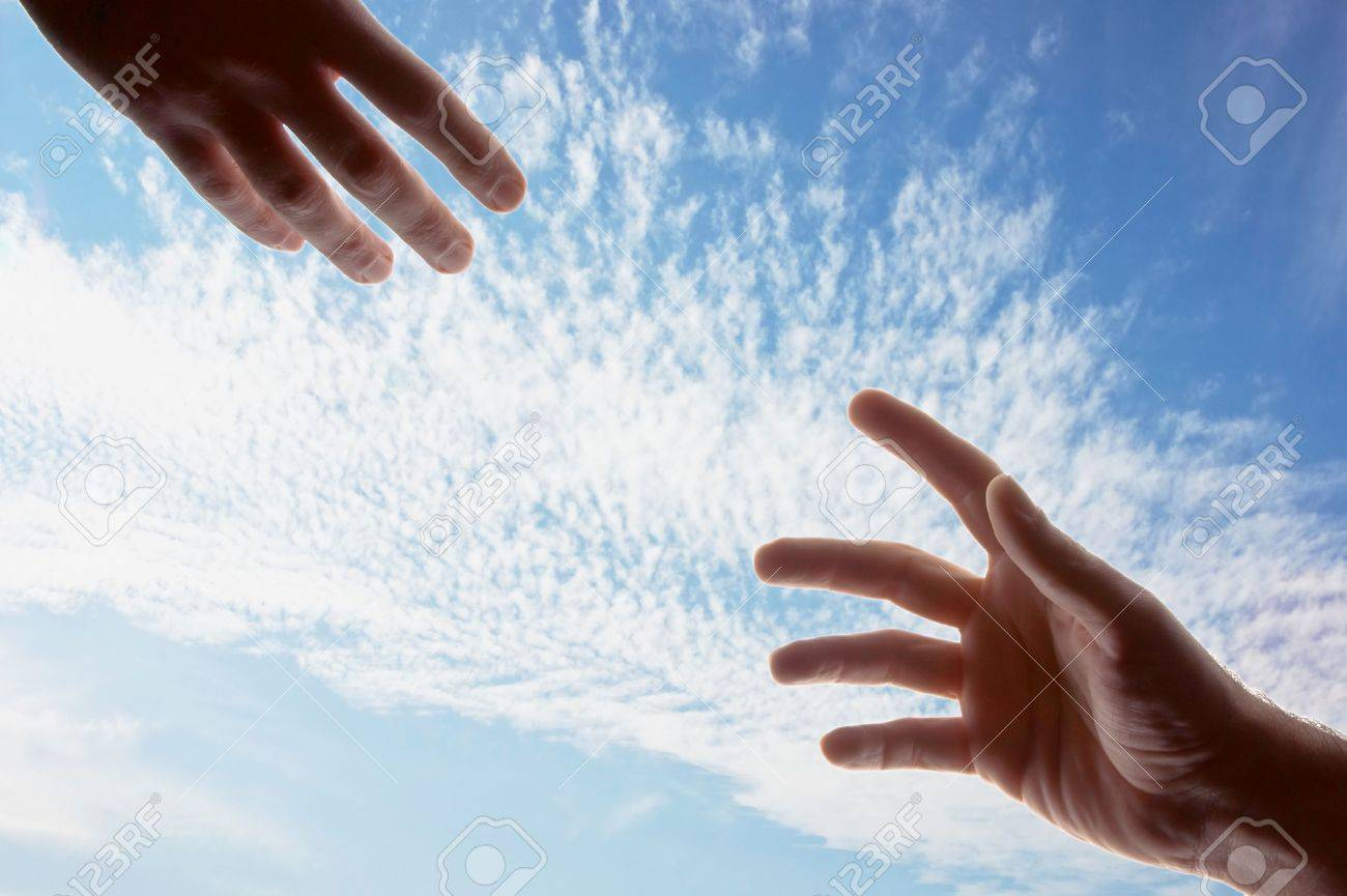 two male hands with fingers outstretched reaching out toward each other Stock Photo - 3901521