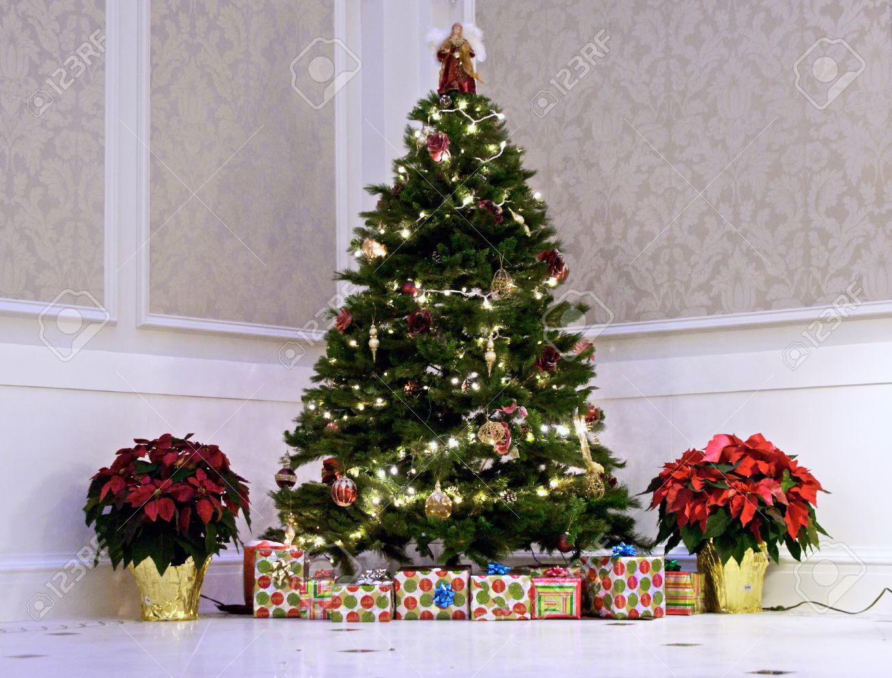 Large Indoor Christmas Tree With Presents And Plants Stock Photo ...