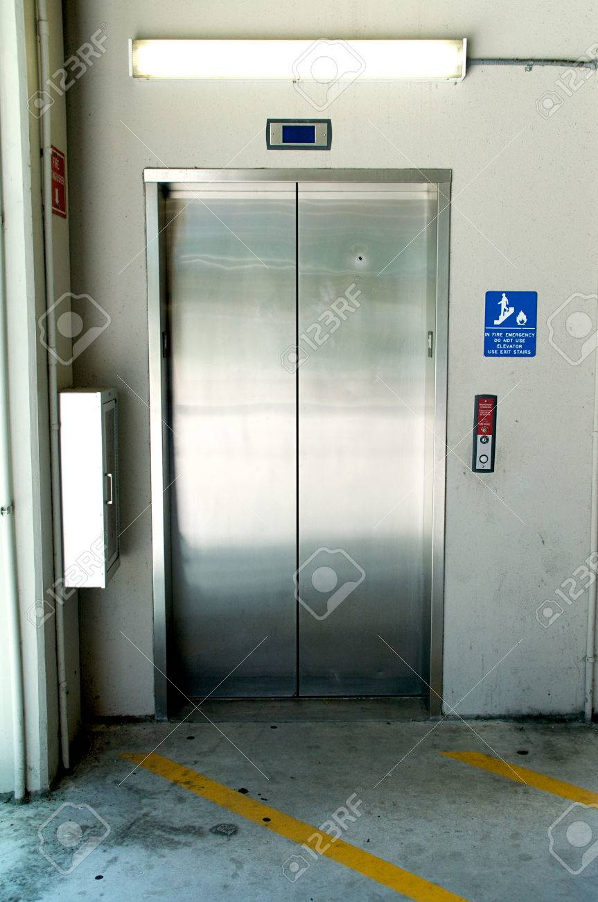 a stainless steel elevator inside a parking garage the doors Elmwood Parking Garage Elevator a stainless steel elevator inside a parking garage the doors are closed stock photo