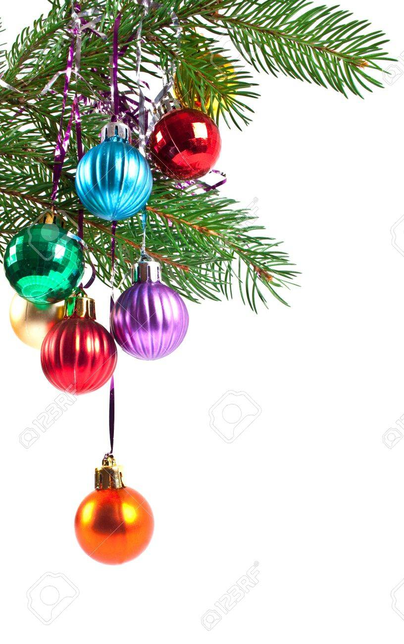 Christmas and new-year decorations. Fir tree branch with decoration on a white background Stock Photo - 8296579