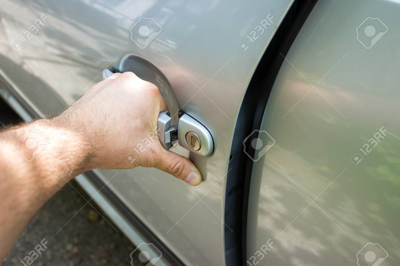 car door handle hand hand on handle closeup of man opening a90 car