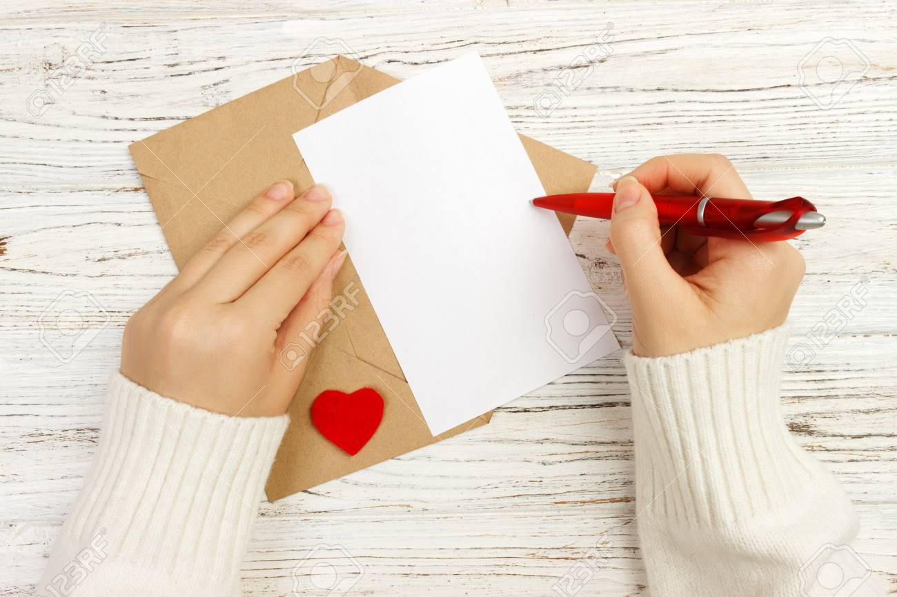 Hand of girl writing love letter on valentine day handmade postcard hand of girl writing love letter on valentine day handmade postcard woman write on expocarfo Choice Image