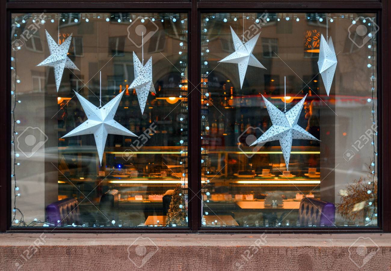 Seasonal Storefront Window Art By >> Stars Of Paper In The Window Of A Cafe Christmas Decoration Stock