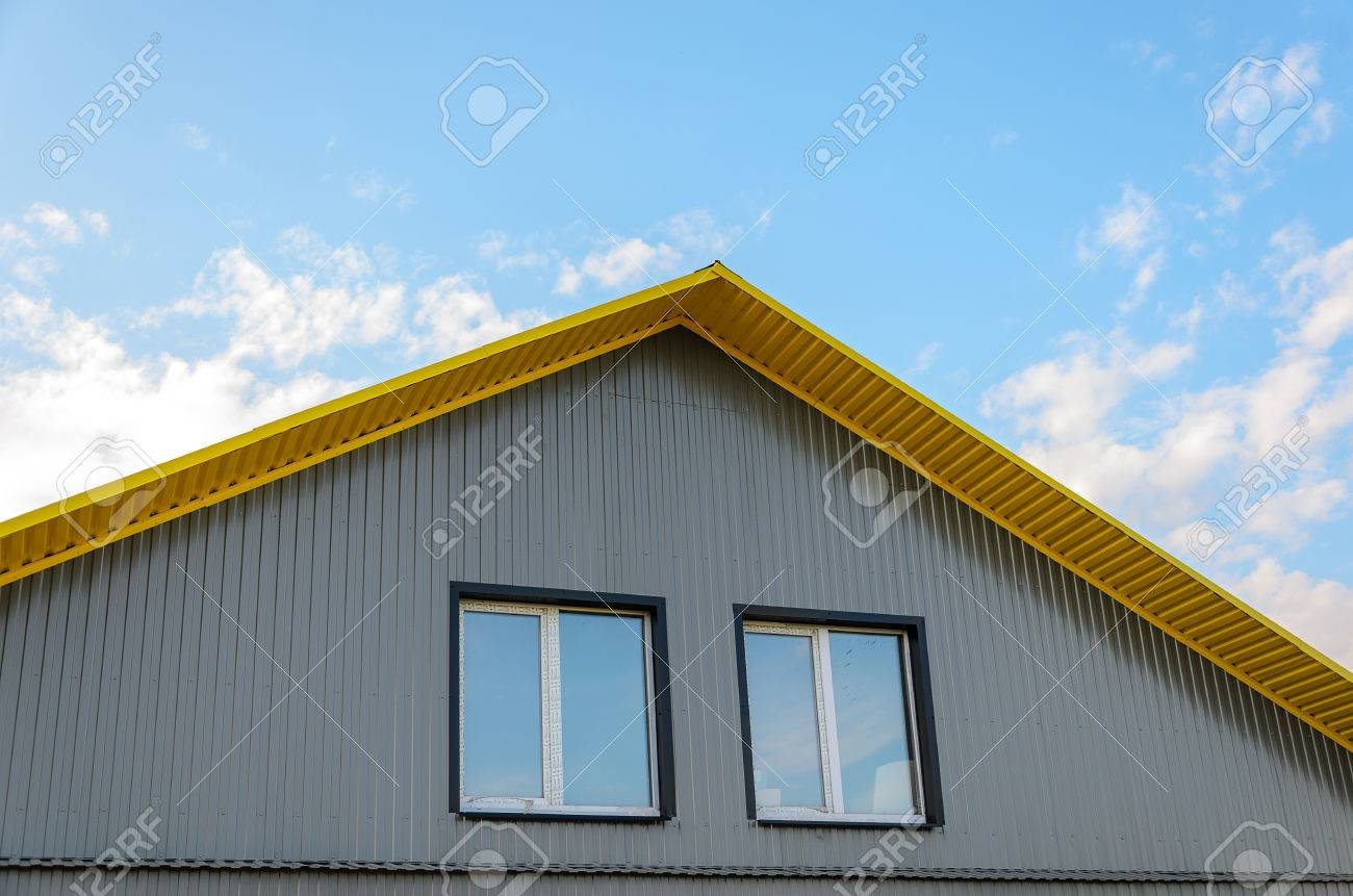Corrugated metal facade pediment with two windows stock photo corrugated metal facade pediment with two windows stock photo 80595893 sciox Image collections