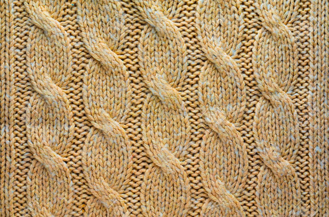 c9308c36371 Knit Texture of Beige Wool Knitted Fabric with Cable Knits Pattern. Blank  Background Stock Photo
