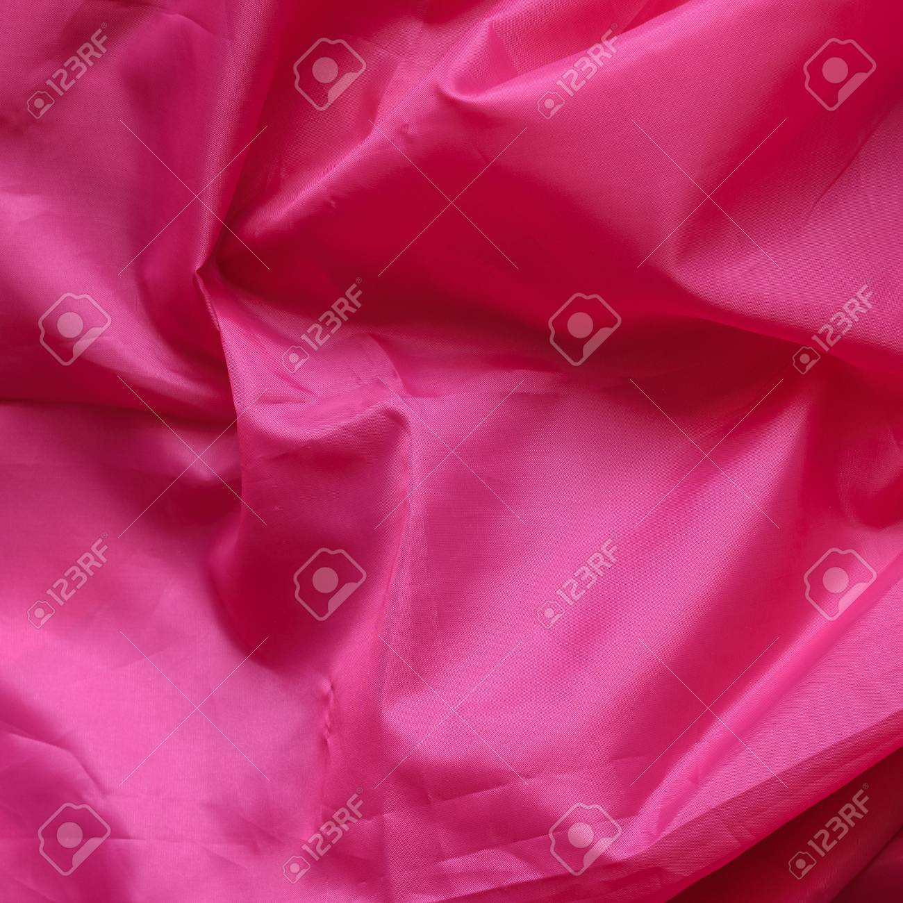 Pink Synthetic Lining Fabric with Folds  Crumpled Sheet or Clothes