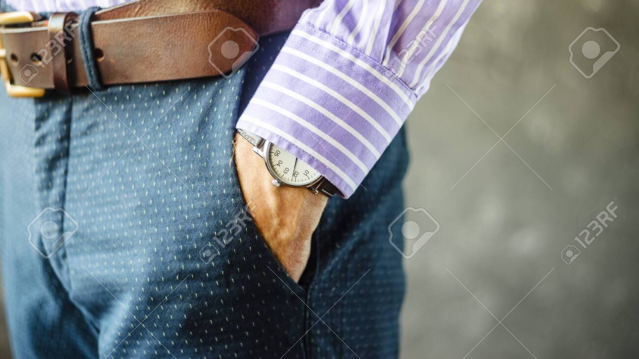 Close Up of Man Hand with Wrist Watch in the Pocket of Stylish