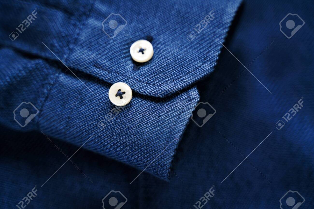 Blue Shirt Sleeve with Buttons. Blue fabric texture. Tailor background - 134771116
