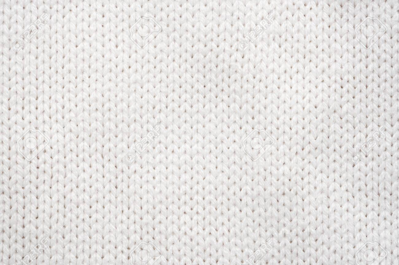 White Knit Fabric Background. Wool Sweater Texture Close Up - 135518217