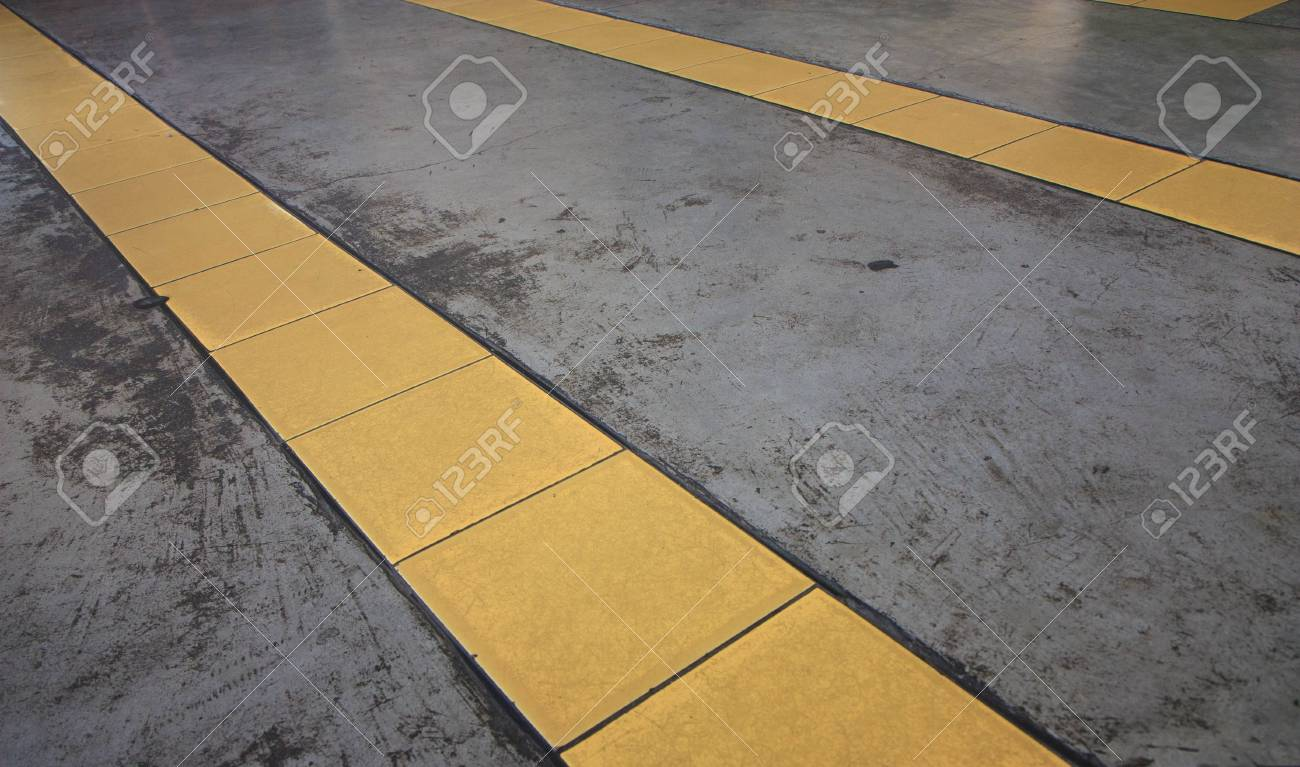 yellow lines on glossy concrete floor Stock Photo - 22424479