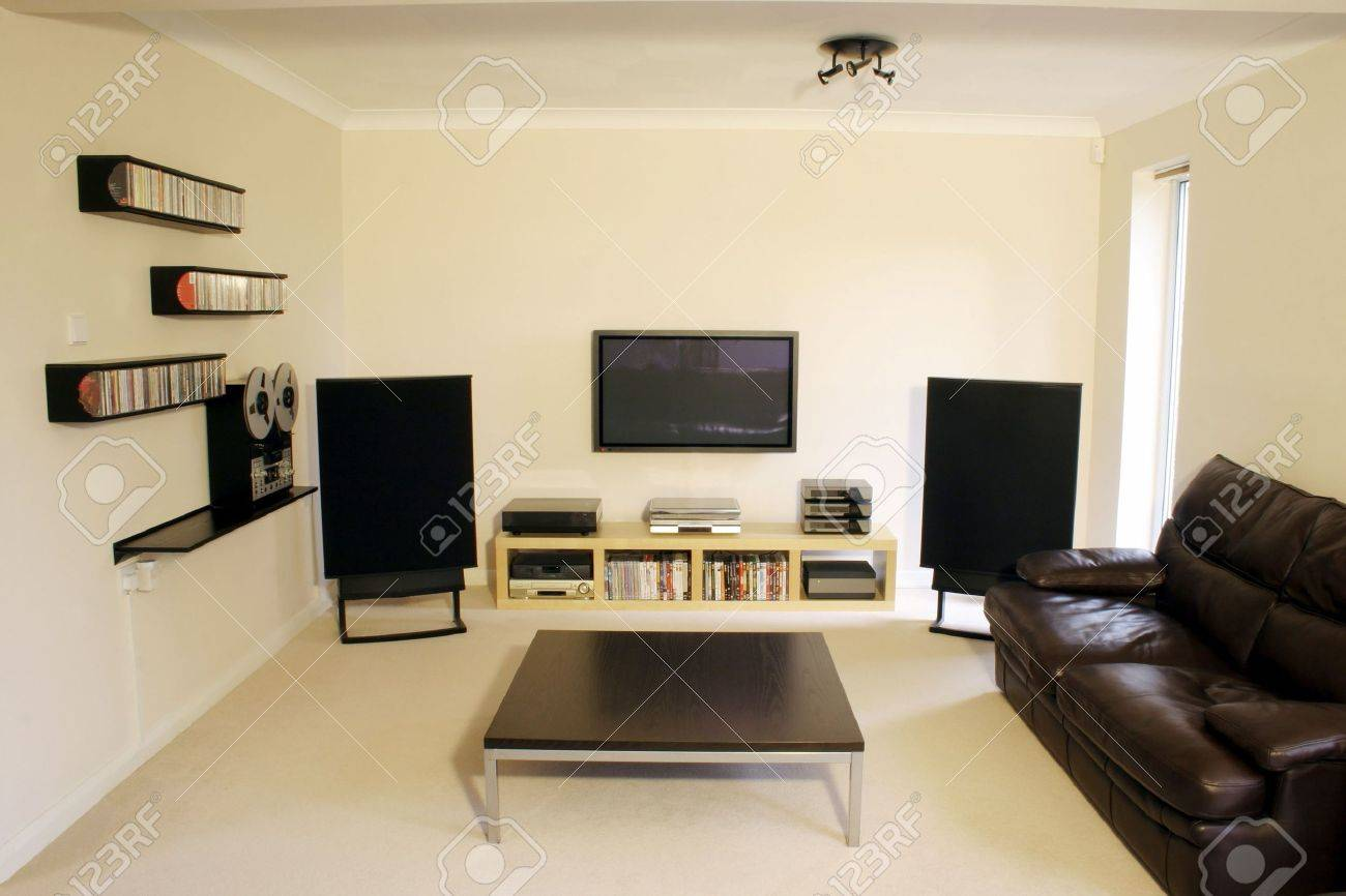 How to setup a home sound system - Plasma Screen And Home Cinema Sound System In Modern Room Stock