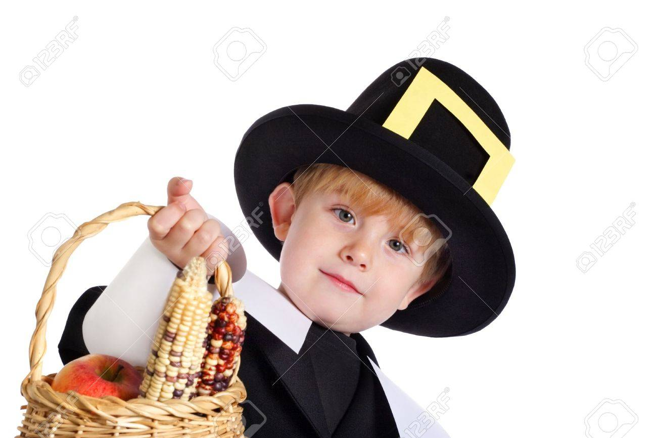 A young boy in a pilgrim costume holds out a basket with indian corn and apples  sc 1 st  123RF.com & A Young Boy In A Pilgrim Costume Holds Out A Basket With Indian ...