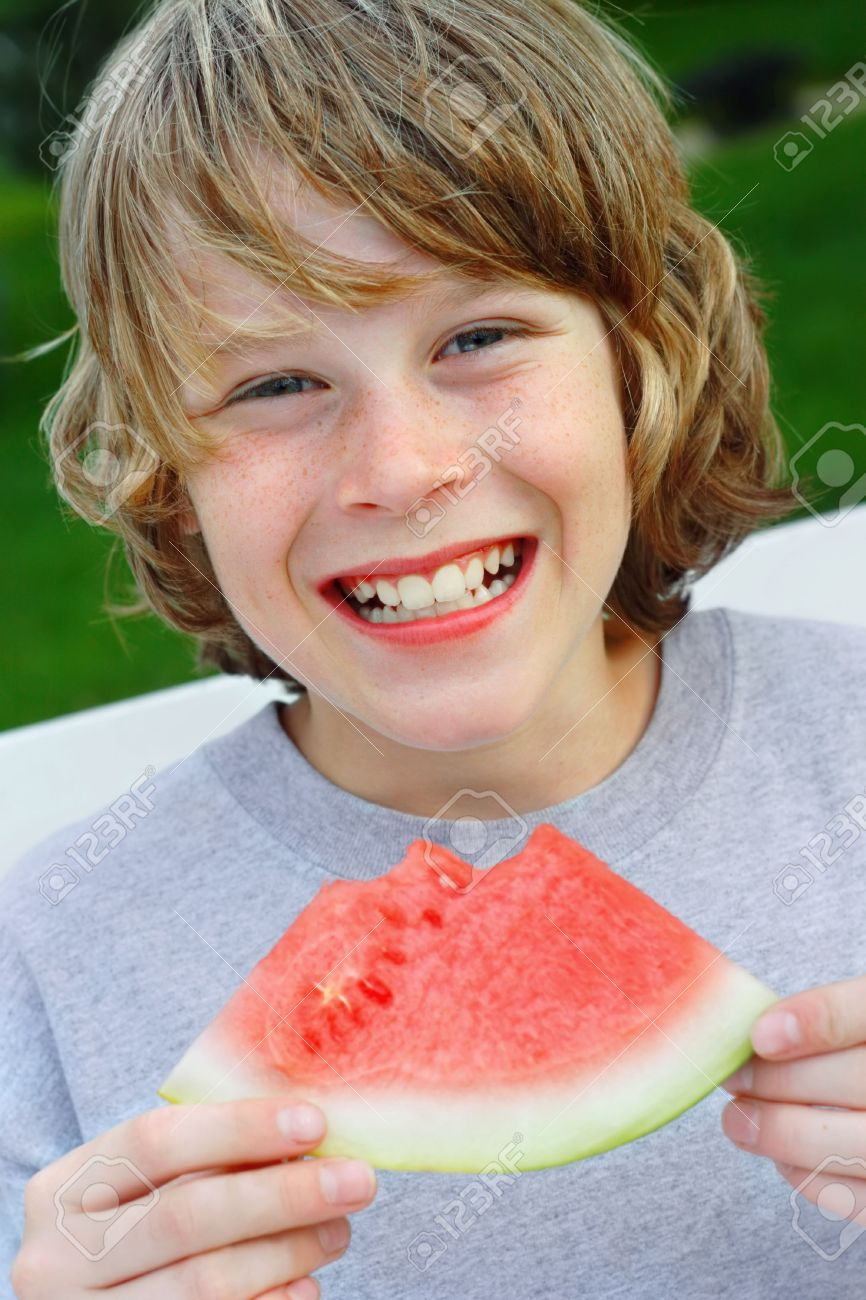 Smiling preteen boy holding a piece of watermelon Stock Photo - 2853110
