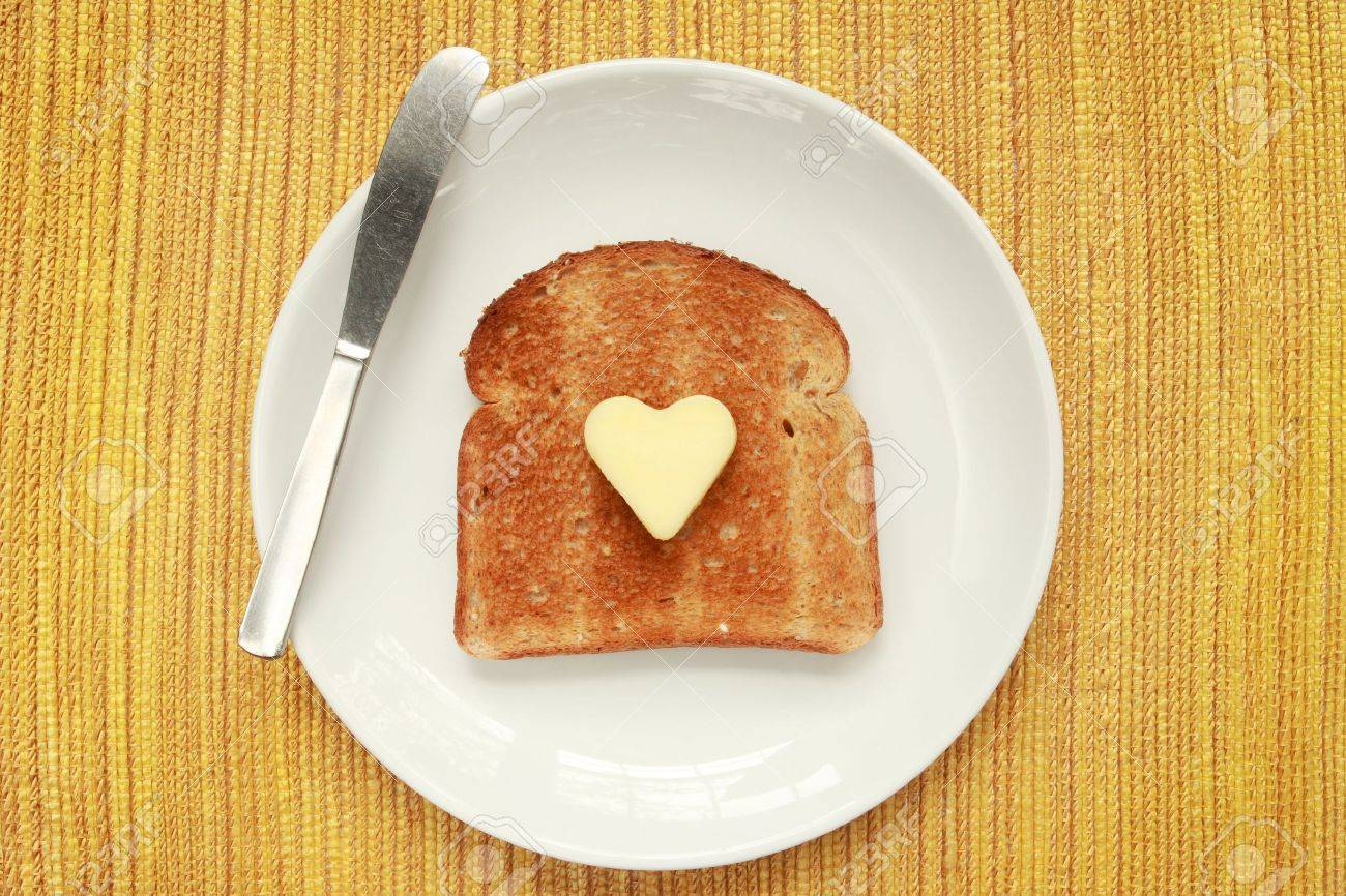A piece of toast on a plate with a heart shaped pat of butter Stock Photo - 3038920