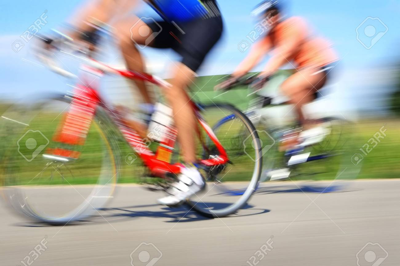 Two bicyclists in a race through the countryside Stock Photo - 3038884